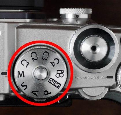 Moduswahlrad mit Belichtungsautomatik einer Olympus PenF